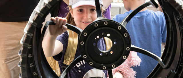 girl playing with wheel